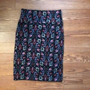 Beautiful worn once Floral on black pencil skirt